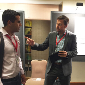 Mike Pennell chats with audience members about OspreyData's Human Augmented machine learning methodology